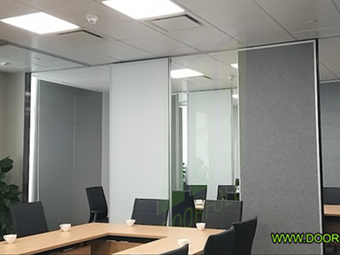 Folding partition in meeting room of office